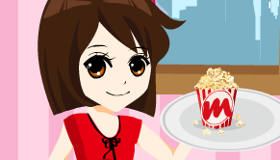 Una chica camarera de palomitas